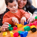 mother and child playing blocks picture