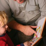 picture of father and son reading